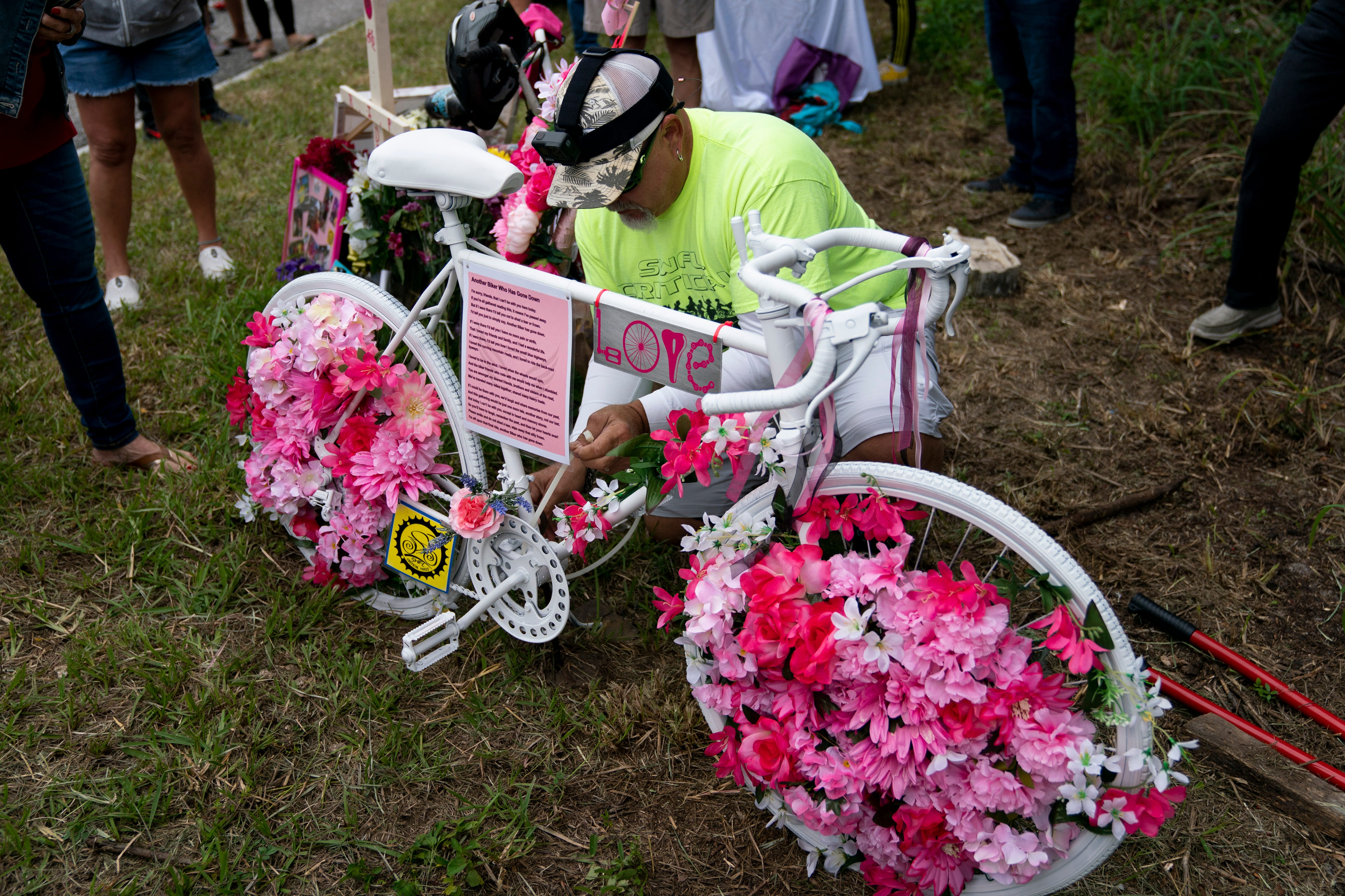 Amid tears and whispers, ghost bike on North River Road honors woman killed and another injured on March 14 3