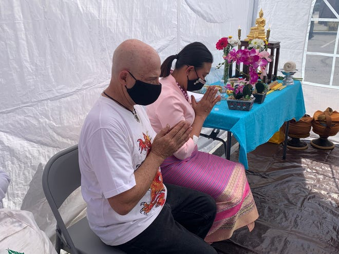 Gene Phillips and Cha Cha Hammond pray during a blessing ceremony at Oriental Thai Massage in Palm Desert Sunday, March 21, 2021. It followed a March 16 attack that left eight people dead at three Atlanta-area massage businesses.