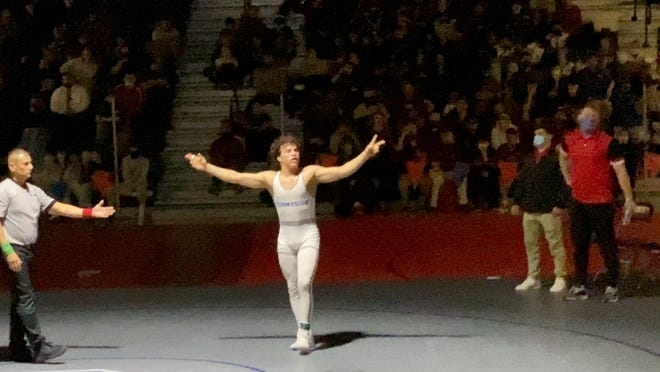 March 21, 2021; Sunnyside senior Sebastian Robles celebrates his individual title win in the 160 at the 2021 Division I state championships at Poston Butte High School in San Tan Valley, Ariz.