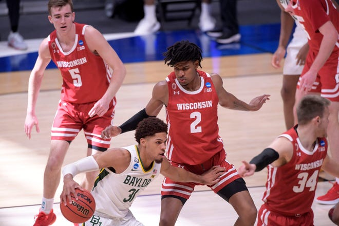 Baylor Bears guard MaCio Teague (31) moves the ball against Wisconsin Badgers forward Aleem Ford (2) in the first half during the second round of the 2021 NCAA Tournament on Sunday, March 21, 2021, at Hinkle Fieldhouse in Indianapolis, Ind.