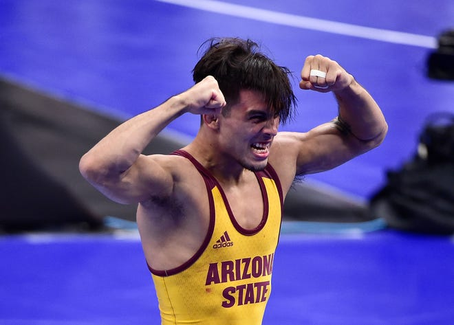 Mar 19, 2021; St. Louis, Missouri, USA; Arizona Sun Devils wrestler Brandon Courtney celebrates after defeating Utah Valley Wolverines wrestler Taylor LaMont in the 125 weight class during the semifinals of the NCAA Division I Wrestling Championships at Enterprise Center. Mandatory Credit: Jeff Curry-USA TODAY Sports