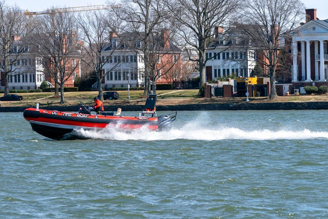 In this Friday March 19, 2021, photo a District of Columbia Fire Boat checks buoys in the waterway next to Fort McNair, seen in background in Washington. Iran has made threats against Fort McNair, a U.S. army base in Washington DC, and against the Army's vice chief of staff, according to two senior U.S. intelligence officials, who spoke on condition of anonymity to discuss national security matters. The threats are one reason the Army has been pushing for more security around the base, which sits alongside the bustling Waterfront district of Washington DC. (AP Photo/Jacquelyn Martin)