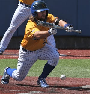 Angelo State University third baseman Jordan Williams lays down a bunt during a Lone Star Conference game against Texas A&M International at Foster Field at 1st Community Credit Union Stadium on Sunday, March 21, 2021.