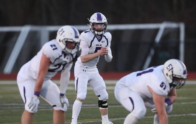 John Jay quarterback Nick Giardina (5) calls the signals during their 21-0 win over Yorktown at Yorktown High School  on Saturday, March 20, 2021.