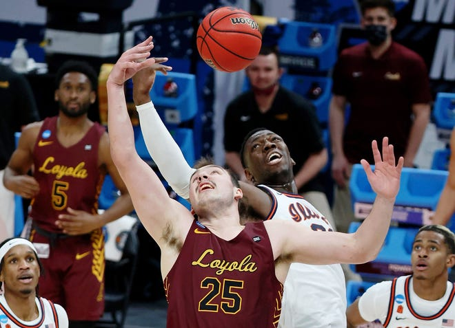 Loyola center Cameron Krutwig and the Ramblers knocked out No. 1 seed Illinois on Sunday.