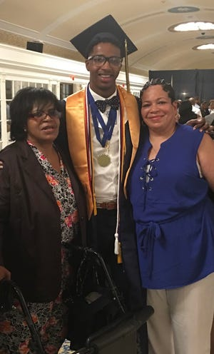 Jamal Holtz with his late grandmother Valerie Holtz (left) and his mother Yvonne Holtz (right) at his 2016 high school graduation at Constitution Hall in Washington, DC.