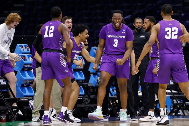 Airion Simmons of Abilene Christian celebrates after drawing a foul against Texas.