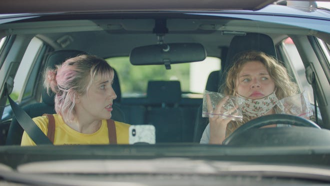 """Whitney Call (left) and Mallory Everton hit the road to rescue their grandma after a COVID outbreak in her nursing home in the pandemic comedy """"Recovery."""""""