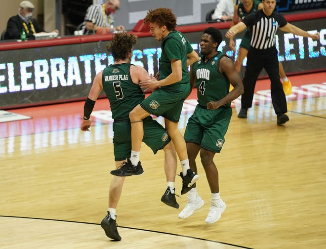 First round: Ohio forward Ben Vander Plas, guard Jason Preston and forward Dwight Wilson III celebrate during the second half of their win against the Virginia Cavaliers at Simon Skjodt Assembly Hall.