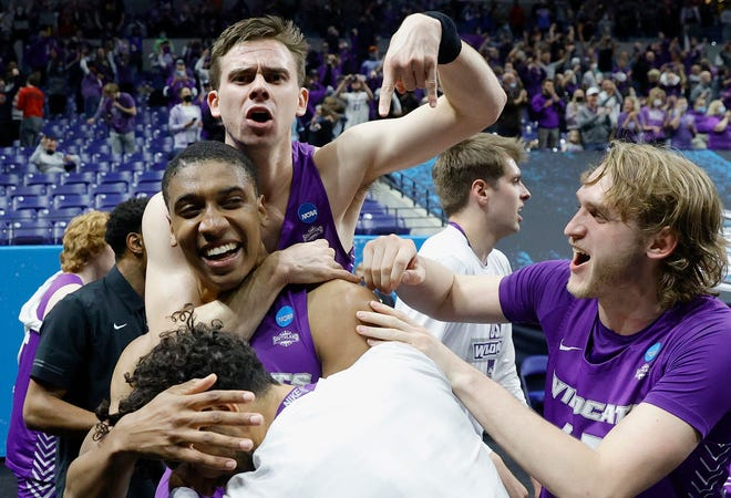 Joe Pleasant of the Abilene Christian Wildcats is surrounded by teammates after his winning free throw to defeat Texas Longhorns 53-52 in the first round game of the 2021 NCAA Men's Basketball Tournament at Lucas Oil Stadium on March 20, 2021 in Indianapolis, Indiana.
