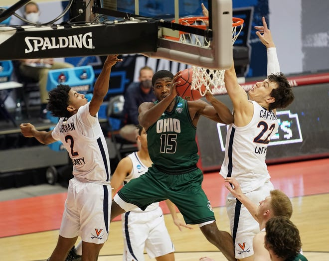 Ohio Bobcats guard Lunden McDay (15) moves to the basket against Virginia Cavaliers guard Reece Beekman (2) and center Francisco Caffaro (22) during the first half in the first round of the 2021 NCAA Tournament at Simon Skjodt Assembly Hall.