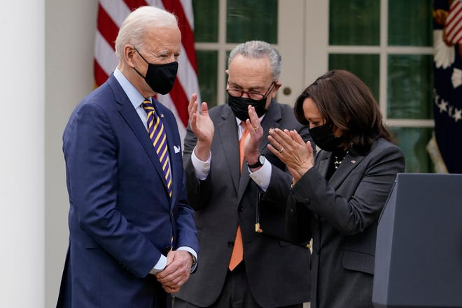 President Joe Biden, Senate Majority Leader Chuck Schumer and Vice President Kamala Harris at the White House on March 12, 2021, in Washington, D.C.