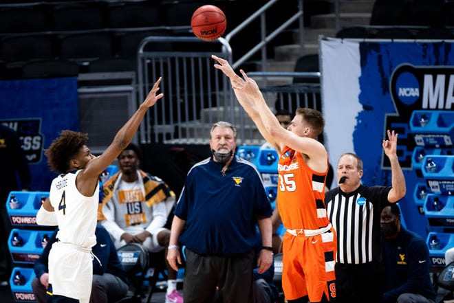 Syracuse guard Buddy Boeheim shoots over West Virginia guard Miles McBride during their second-round matchup.
