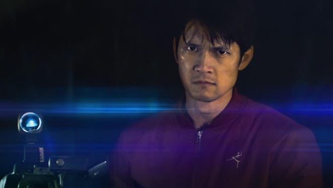 """Harry Shum Jr. is a video archivist who goes down the strange rabbit hole of a video hacking in """"Broadcast Signal Intrusion."""""""