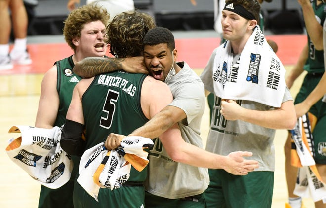 Bobcats players embrace forward Ben Vander Plas following their win over the Cavaliers.