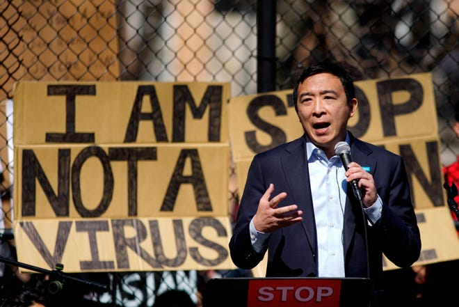 Democratic mayoral candidate Andrew Yang speaks to people as they take part in a rally against hate and racism at Columbus Park in Chinatown, on Sunday, March 21, 2021, in New York.