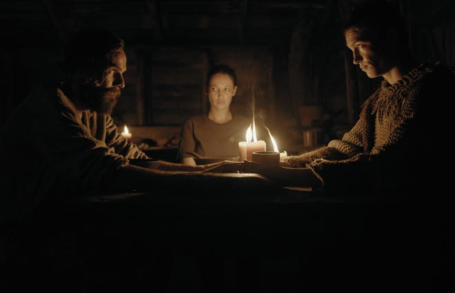"""An injured park ranger (Monique Rockman, center) is taken in by a couple of strange survivalists (Carel Nel and Alex van Dyk) in """"Gaia."""""""