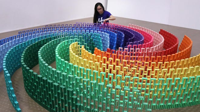 """Lily Hevesh, a champion domino artist, is the subject of the documentary """"Lily Topples the World."""""""
