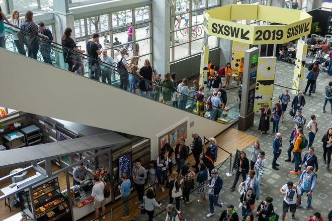 Festival goers move through SXSW at the Austin Convention Center, Sunday, March 10, 2019. [Stephen Spillman for Statesman]