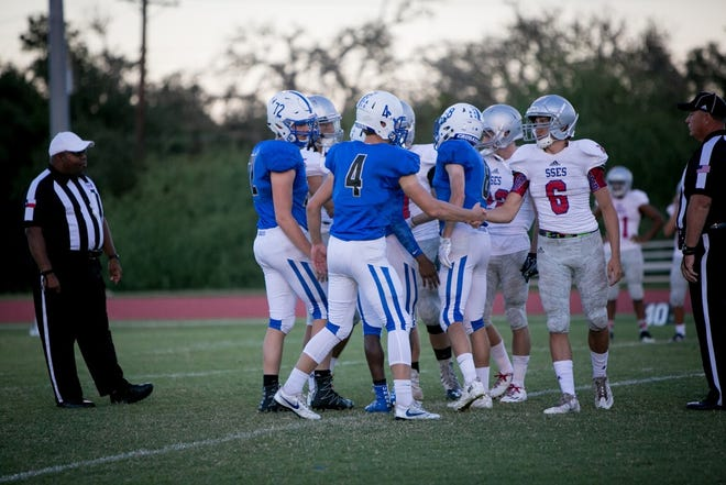 St. Andrew's and St. Stephen's football players meet before the start of their 2016 game. The two West Austin Episcopal schools combined their programs from 2018-20 but will compete as separate programs again beginning this fall.
