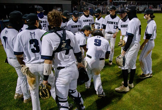 Hendrickson's baseball team gathers for a victory celebration after beating Bastrop in a District 18-5A game last week. The Hawks enter this week 2-0 in district play.