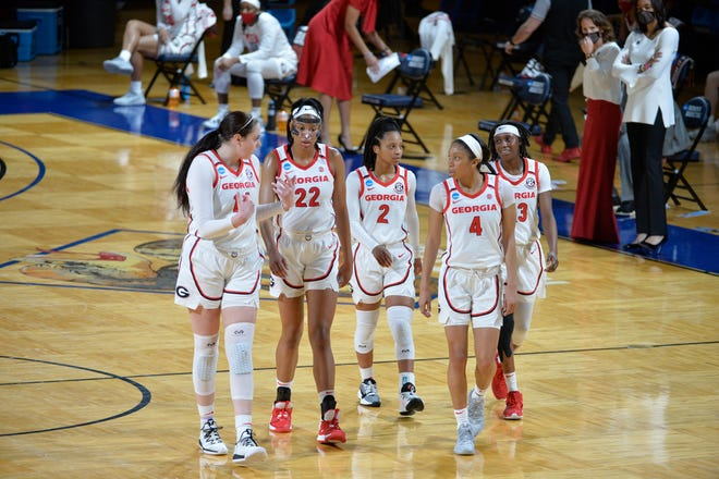 Georgia players enna Staiti (14), Malury Bates (22), Gabby Connally (2), Mikayla Coombs (4), and Que Morrison (23) during the Lady BulldogsÕ game against Drexel in the first round of the NCAA Tournament in San Antonio, Texas, on Monday, March 22, 2021. (Photo by Mark Sobhani)
