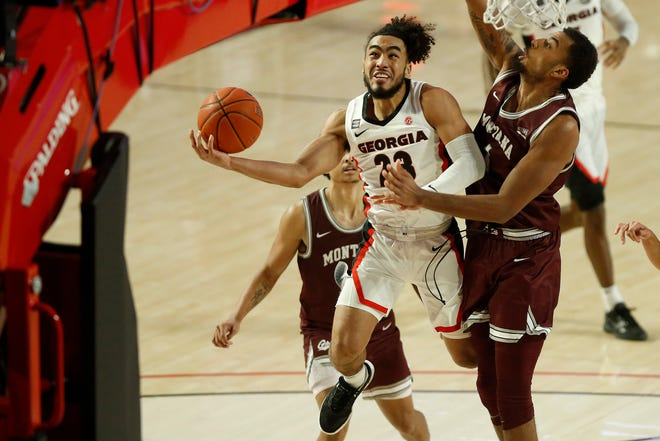 Georgia's Mikal Starks (23) takes a shot while being defended by Montana forward Michael Steadman (1) during a game between Georgia and Montana in Athens, Ga., on Tuesday, Dec. 8, 2020. Georgia won 63-50. (Photo/Joshua L. Jones, Athens Banner-Herald)
