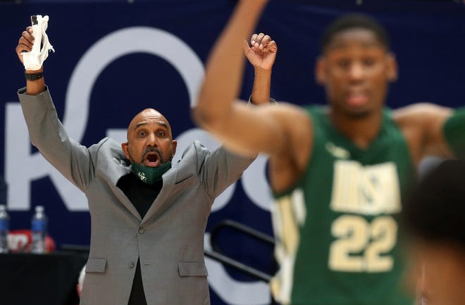 St. Vincent-St. Mary boys basketball coach Dru Joyce, back, will be taking his premier U.S, travel basketball tournament, the Dru Joyce Classic to Rocket Mortgage FieldHouse and the Huntington Convention Center in June. [Jeff Lange/Beacon Journal]
