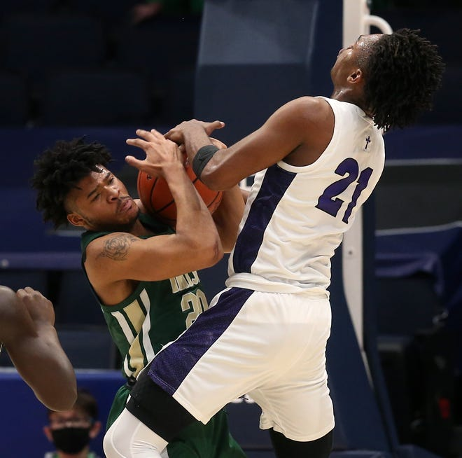 St. Vincent-St. Mary junior Ramar Pryor, left, battles for a rebound against Columbus St. Francis DeSales' Desmond Watson during the Division II state championship game Sunday. Pryor and junior Sencire Harris are already looking ahead to continuing the STVM legacy. [Jeff Lange/Beacon Journal]