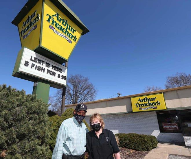 Robert Allen, left, former regional supervisor and multiple franchise owner, and restaurant manager Gina Jordan at one of only two Arthur Treacher's Fish & Chips restaurants nationwide in Cuyahoga Falls.