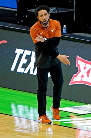 Mar 20, 2021; Indianapolis, Indiana, USA; Texas Longhorns head coach Shaka Smart reacts during the first half against the Abilene Christian Wildcats in the first round of the 2021 NCAA Tournament at Lucas Oil Stadium.