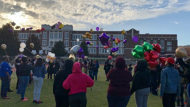 Family and friends of Tammy Briggs and April Williams, who were killed March 14, 2021, release balloons in their memory in front of alma mater Academy of Richmond County.