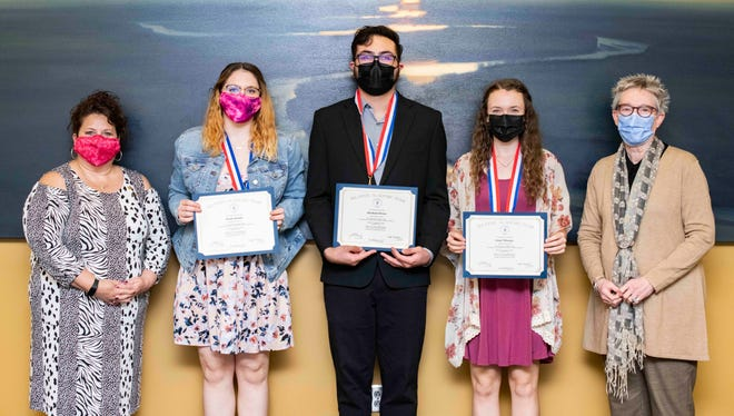 From left, Chrissy Baker, PTK advisor; Kaylie Hansen, pre-medicine student; Abraham Olvera, software development student; Jessie Nibarger, elementary education/BEST student, Kim Krull, president stand for a photo during the PTK Kansas All-State Academic Team Awards virtual ceremony. Each student received a medallion and scholarship.
