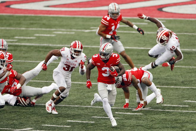 Ohio State Buckeyes running back Demario McCall (3) returns a kickoff against Indiana Hoosiers during the fourth quarter in their NCAA Division I football game on Saturday, Nov. 21, 2020 at Ohio Stadium in Columbus, Ohio.