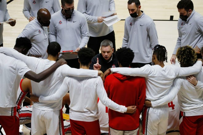 Ohio State coach Chris Holtmann talks to his players during a timeout against Oral Roberts in the first round of the 2021 NCAA Tournament on March 19.