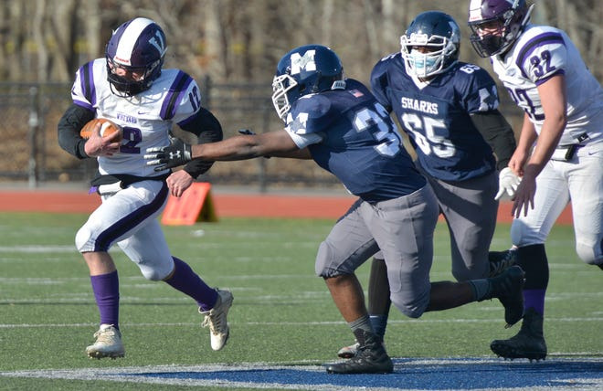 Monomoy's Marc Cherry, second from left, tries to tackle Oscar Shepherd of Martha's Vineyard during Monday's game in Harwich.