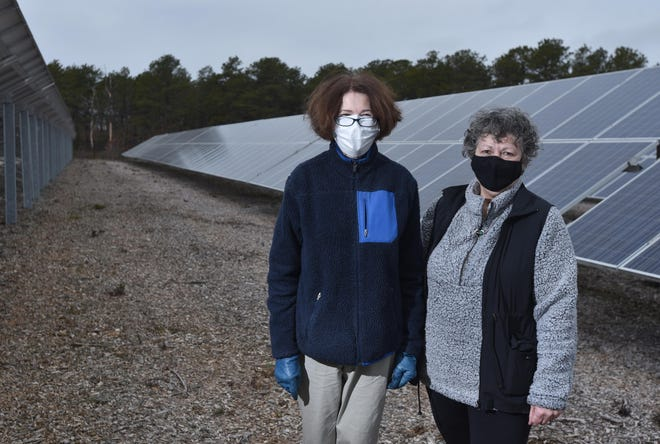 SOUTH YARMOUTH  3/18/21 Joyce Flynn and Sandy Cashman, right in a solar panel field behind the Dennis-Yarmouth High School. 