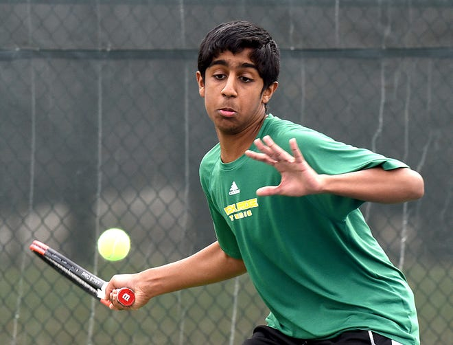 Rock Bridge junior Akhil Elangovan returns the ball against Liberty during a match March 22 at Cosmo-Bethel Park.