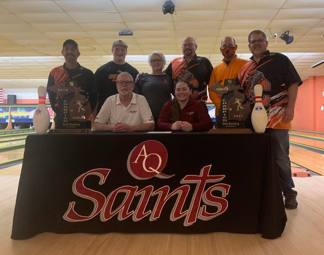 Cheboygan senior girls bowler Morgan Jones officially committed to bowl at Aquinas College for next season. Jones, who helped lead Cheboygan to a Division 3 team regional title, also captured the girls singles crown on Saturday. In this photo with Jones are (front, from left) Aquinas bowling coach Charlie Tapp, (back, from left) Cheboygan assistant coach Tony Webber, brother Tommy Jones, parents Stephanie and Rod Jones, Cheboygan athletic director Jason Friday, and Cheboygan varsity bowling head coach Brian Taylor.
