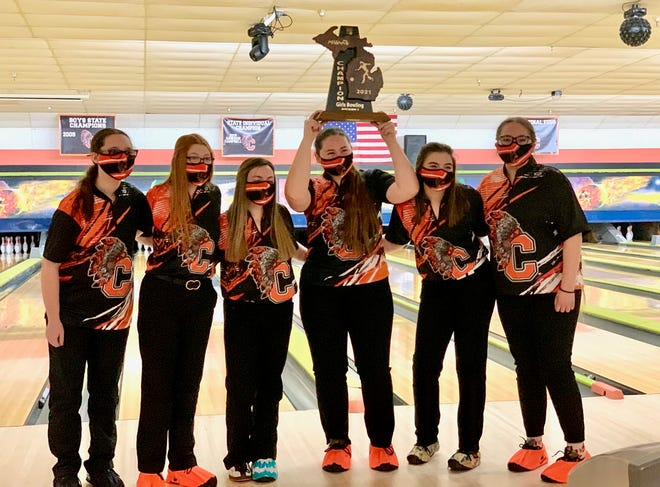 The Cheboygan varsity girls bowling team holds up the trophy after winning the Division 3 team regional title at Spare Time Lanes in Cheboygan on Saturday. Members of the Cheboygan team include (from left) Jenna Knaffle, Izzy Portman, Zoey Bur, Morgan Jones (holding the trophy), Jenna Webber and Izzy Taylor.