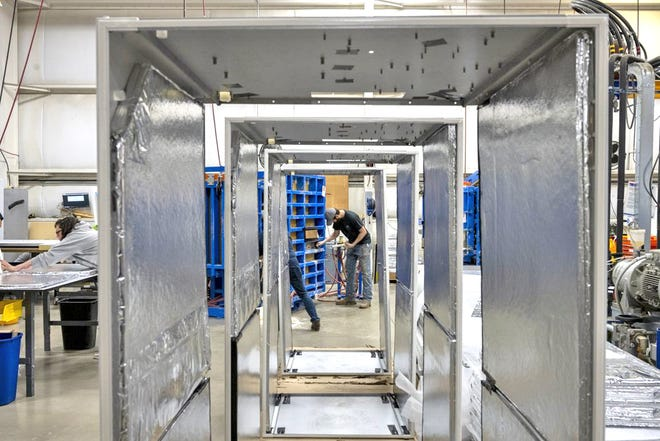Technicians assemble ultra-low temperature freezers at Stirling Ultracold's manufacturing facility in Athens.