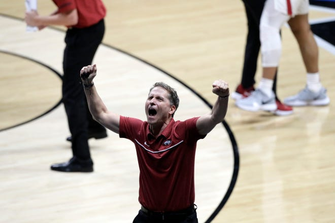 Arkansas Razorbacks Head Coach Eric Musselman gestures to his team during the second round of the 2021 NCAA Tournament on Sunday, March 21, 2021, at Hinkle Fieldhouse in Indianapolis, Ind.