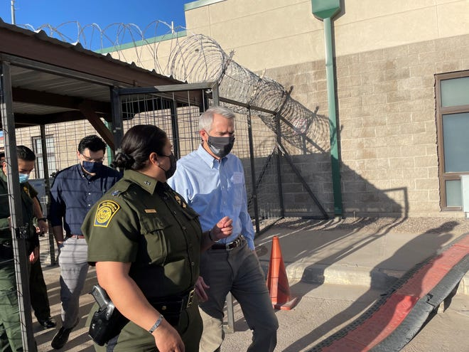 Ohio Sen. Rob Portman visits a processing station near the Mexican border with Gloria Chavez, chief patrol agent for the U.S. Border Patrol's El Paso Sector.