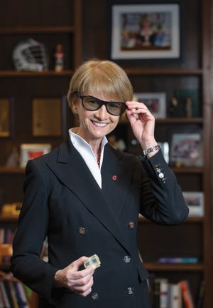 OSU president Kristina Johnson wearing the 3D glasses she helped develop.