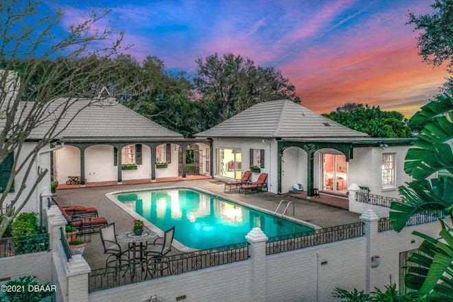 The elevated pool deck, which offers complete privacy and unparalleled views of the Intercoastal Waterway and the deep-water dock, is shared by the fully equipped pool house.