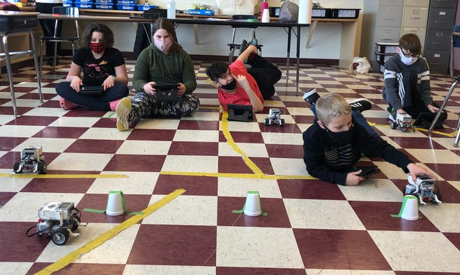 ASAP robots: Dansville Central School fifth graders accepted the challenge to program the Lego EV3 robots they built to race around a pylon and back again, the winner being the robot with the fastest time.