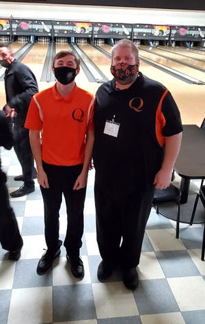 Quincy's Brandt Neely, shown here with his coach Andrew Craig, claimed the crown at the D3 Regional Bowling tournament this past weekend