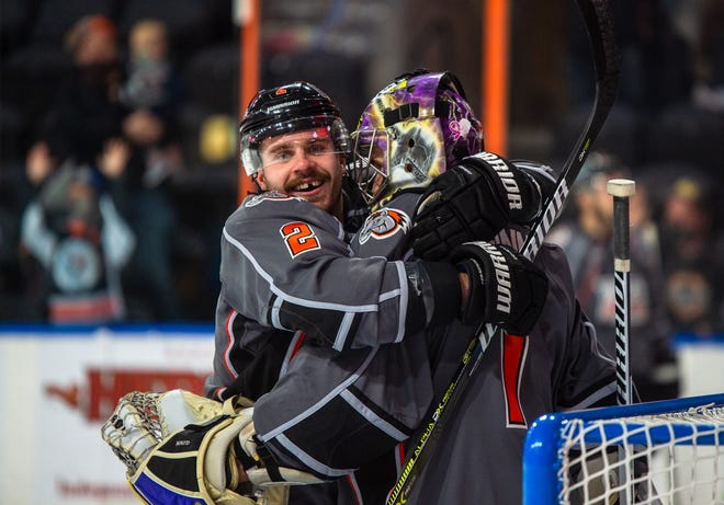 Kansas City Mavericks defenseman Zach Osburn (2) hugs goalie Matt Ginn (1) after the Mavericks stopped the Indy Fuel for a 6-3 victory Sunday at Cable Dahmer Arena. Ginn finally got some offensive support as Jared VanWormer and Brodie Reid each scored hat tricks.