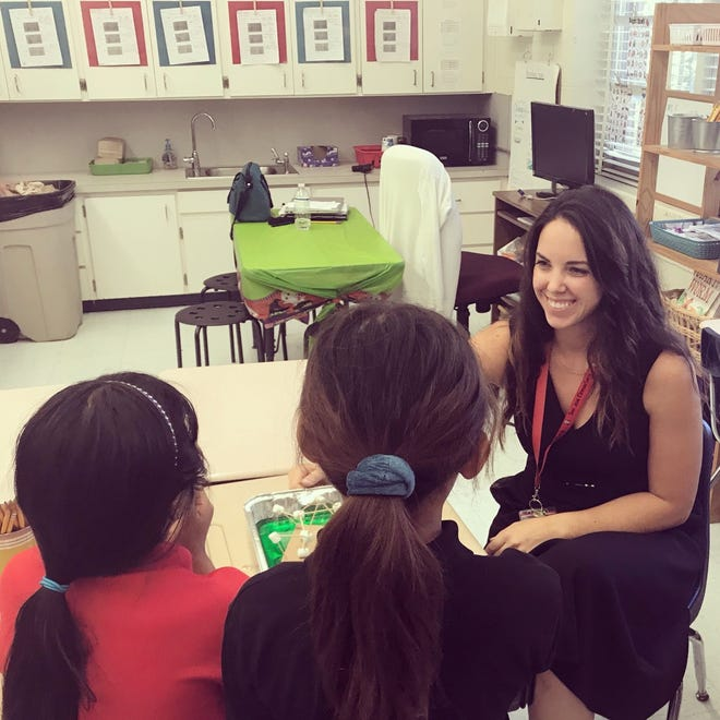 Caran Mullins with students at San Jose Elementary School.
