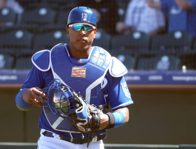 Salvador Perez of the Kansas City Royals looks on in the fourth inning against the Los Angeles Angels during a MLB spring training game at Surprise Stadium on Friday, March 19, 2021 in Surprise, Ariz.